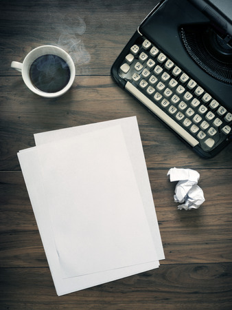 letter writing: A Vintage Typewriter on a wooden table with coffee and paper. Vintage office space. blank paper