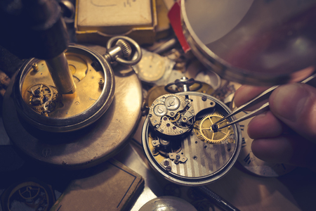 Watchmakers Craftmanship. A watch maker repairing a vintage automatic watch. 스톡 콘텐츠