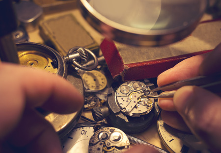 craftman: Watchmakers Craftmanship. A watch maker repairing a vintage automatic watch. Stock Photo