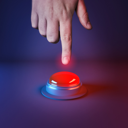 panic button: Pushing A Panic Button. A person about to press a big red button.