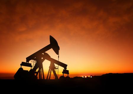 brent crude: Oil Pumps at Dusk. Oil pumps producing oil at dusk.
