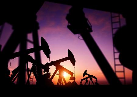 brent: Oil Pumps at Dusk. Oil pumps producing oil at dusk.
