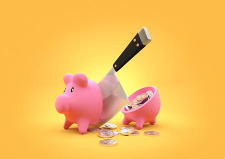 sliced: slashed Savings. A piggy bank cut in half with a butchers cleaver. Money concept.