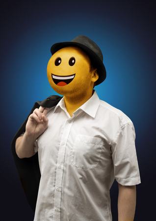 A happy surreal businessman with a playful yellow happy face emoticon portrait.