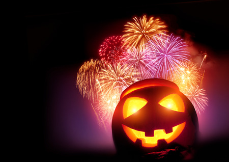 Halloween fireworks party with a glowing pumpkin, October celebrations! Фото со стока