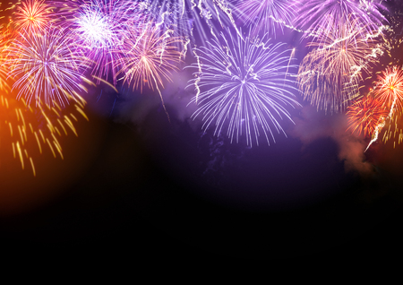 Bright Fireworks display celebrations background with copy space. Stock Photo
