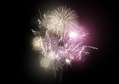 guy fawkes night: A large bright fireworks display event with gold and pink rocket breaks. Archivio Fotografico