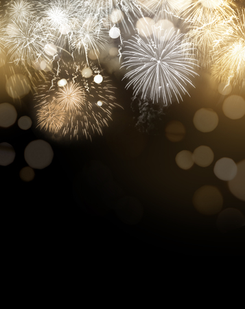 Bright gold dazzling Fireworks display celebrations background with copy space. Stock Photo