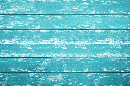 A blue and rustic wood table background with chipped paint, top down view. Stock Photo