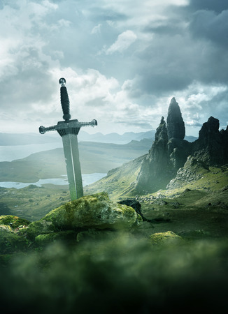 An aged knights sword stuck in the ground with the rolling mountains from the Isle of Skye in the background. Fantasy 3D mixed media illustration.