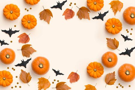 Autumn fall  contemporary background composition with pumpkins and leaves with room for text. Banco de Imagens