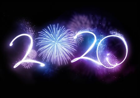 The year 2020 displayed with fireworks and strobes. New year celebration concept. Stock Photo