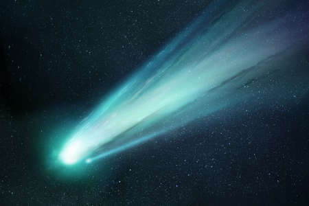 Comet Neowise passing the sun and releasing gases creating a tail and coma. Illustration.
