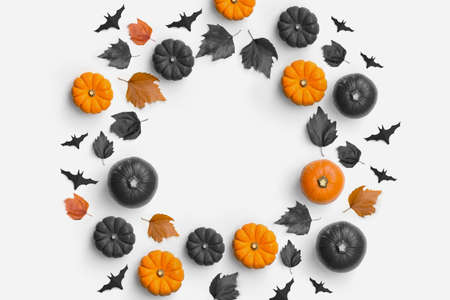 Autumn fall contemporary halloween background composition with pumpkins and leaves in a circle shape. 写真素材