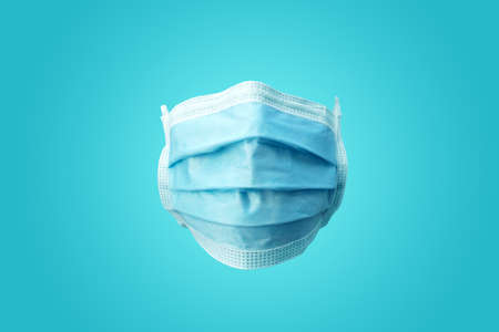 A plain blue medical Surgical protection face mask. Front facing view. 写真素材
