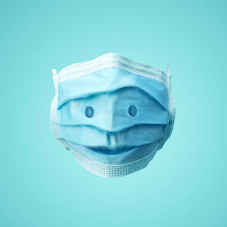 A smiling face on a medical protection face mask. Concept Illustration