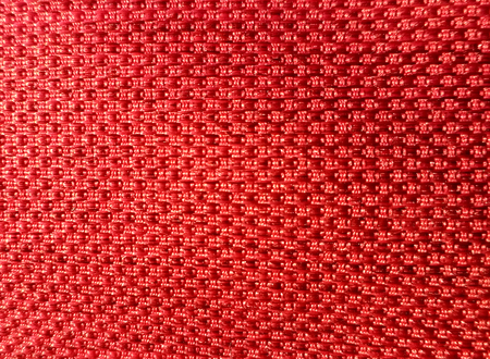 Red fabric texture background. Macro photography.
