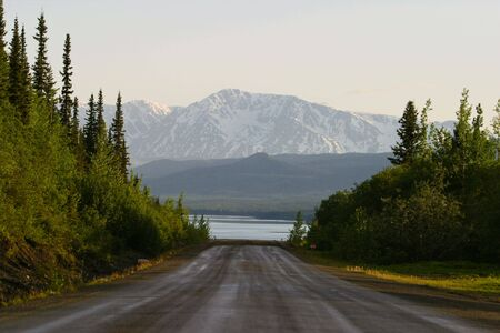 End of a Section of Paved Road, Cassiar Highway, British Columbia, late afternoon Stok Fotoğraf