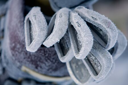 were: Golf clubs covered in a thick layer of hoarfrost; were left outside in subzero weather for weeks Stock Photo
