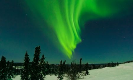 X class solar flare induced aurora on Cleary Summit, north of Fairbanks Alaska
