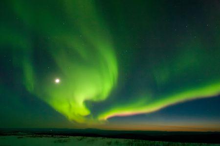 Aurora in moonlight, early twilight, Murphy Dome, north of Fairbanks Alaska