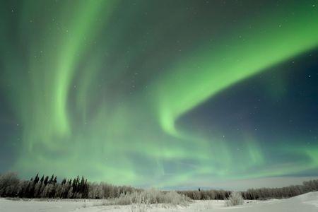Aurora over Frozen Lake, north of Fairbanks, Alaska Stock Photo