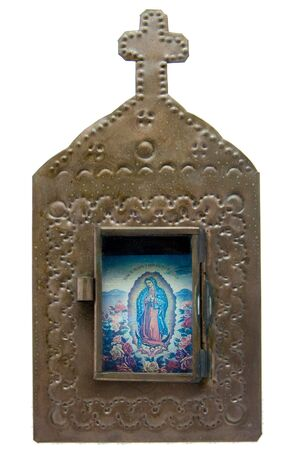 A church-shaped metal frame with a door, containing a print of the Virgin Mary (Our Lady of Guadalupe) Stok Fotoğraf