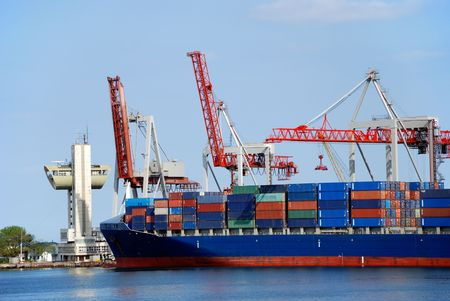 The cargo ship with containers unloads in port Stock Photo - 3109104