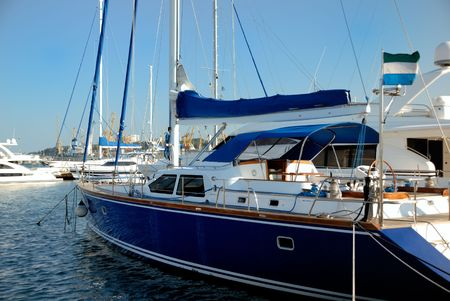 odessa: Dark blue sailing yacht on an anchor in harbour Stock Photo