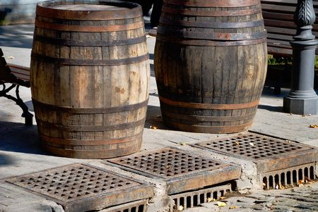 Two wooden cask for wine in the street photo