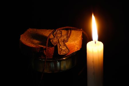 rood: Composition from a burning candle, rood, glass with water and breads Stock Photo