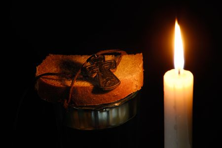 rood: Composition from a burning candle, rood, a glass with water and breads