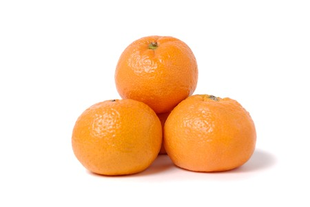 Four tangerines in the form of a pyramid on white Stock Photo - 4022775