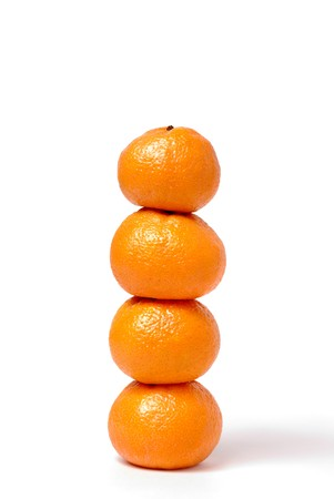 Four tangerines in the form of a column on white Stock Photo - 4022777
