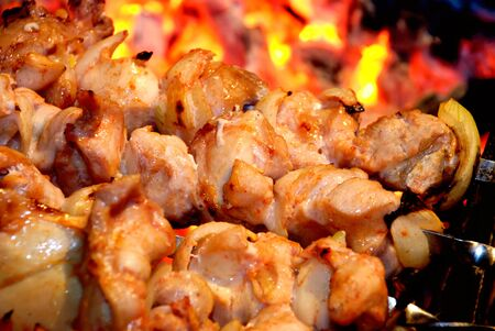 Traditional preparation of a shish kebab on fire photo