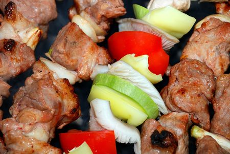 The shish kebab with vegetables prepares on fire Stock Photo - 5038039