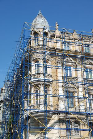 The scaffolding near a facade of a building for restoration photo