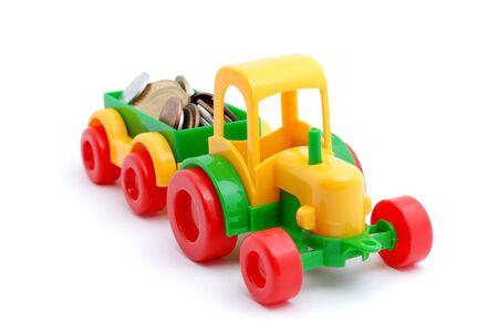 honorarium: The toy excavator wheels money on white background