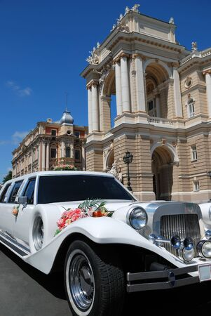 adorning: White wedding limousine near the magnificent house