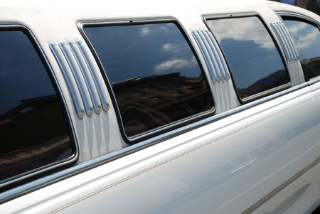 cater: Window and roof of the white limousine