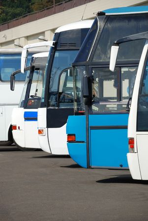 Tourist buses on a parking expect passengers photo