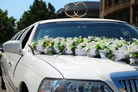 White wedding limousine decorated with flowers photo