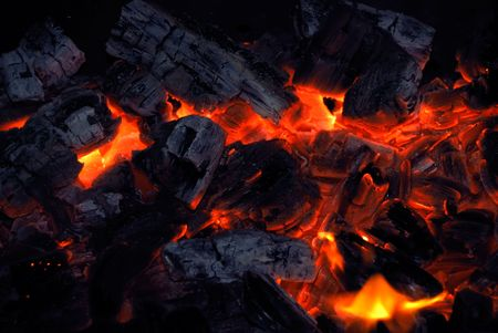incandescence: Closeup of the burning charcoal on dark