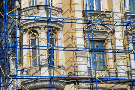 restoration: The scaffolding near a facade of a building for restoration