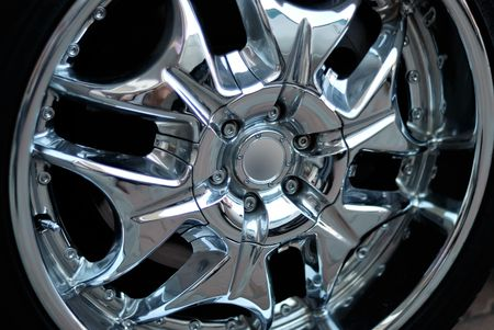 Closeup the chromeplated rim of a wheel Stock Photo - 5431117