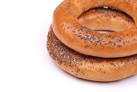 Two big bagels with a poppy on a white background photo