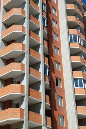 Facade of a condominium of coming to the end building Stock Photo - 5464973