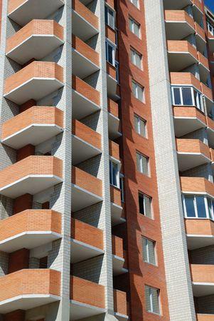 Facade of a condominium of coming to the end building Stock Photo - 5464973