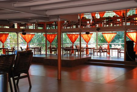 Interior of a summer open-air cafe with red curtains Stock Photo - 5537688