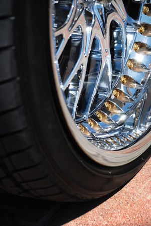 Closeup the chromeplated rim of a wheel Stock Photo - 5550965